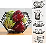 """FOLDING WIRE BASKET NOT JUST FOR FRUIT! Use for bread, toiletries, decorative items and more! FLEXES INTO 5 DIFFERENT SHAPES. Create your own design MADE OF DURABLE STAINLESS STEEL. No rusting MEASURES 12"""" DIAM. FLAT AND EXTENDS TO 7.2"""" H OPEN"""