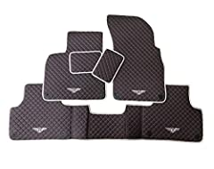 Kit-Car Black Floor Mats for Bentley Bentayga 2017-18. Premium High-Quality Floor Mat Set for your car. Material: Durable Eco-Leather. Color: Brown. Stitched with a Strong White Thread. Black n White Embroidery on all 4 floor mats. Improve your car i...