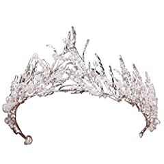 Material: Metal, crystal and pearls. Size: approximately 11.4 inches in arc length, 2.5 inches in height Weight: approximately 0.075 KG (0.16 BL). No gift box. Well crafted wedding hair accessory. Each of our piece is handmade so there might be sligh...