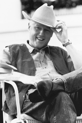 Bill Clinton classic smile seated in chair wearing stetson 24x36 Poster