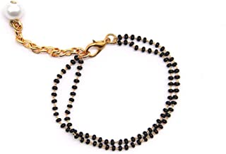 The Bling Stores Simple Mangalsutra Chain Bracelet with a pearl is attached to a string of black & gold tone beads