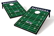 "Seattle Seahawks - official NFL merchandise! This football field style corn hole board set celebrates your Hawks, and is sized right for tailgate parties and grilling picnics. The two included boards, the ""endzones"", and all eight durable, regulation..."
