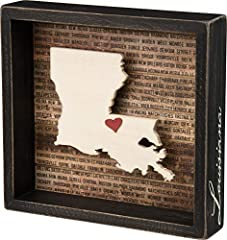 Inset box sign with a dimensional Louisiana state silhouette and background list of the most populated cities Measures 8.5 x 8-inches; black distressed style frame with the state name hand lettered on side of frame Includes adhesive mini red heart to...