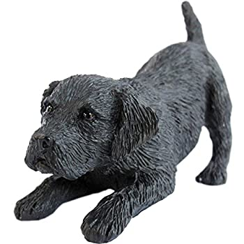statue of black lab puppy getting ready to play