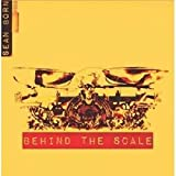BEHIND THE SCALE