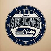 """Hand-painted in Art Glass 12"""" diameter Team colors and logos Takes 1AA battery Battery not included."""