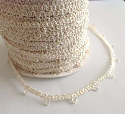 Nakpunar 12' Ivory Elastic Button Loops - 1' Space - for Bridal Gowns, Trails