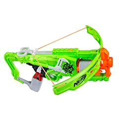This version comes in simple brown packaging 5 dart rotating drum Real crossbow action Fires 1 dart at a time Includes blaster, bow arms, 5 darts, and instructions. Do not aim at eyes or face, to avoid injury use only darts designed for this product....