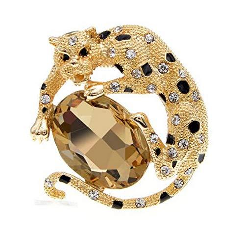 Broche con diseño de pantera dorado y negro, acero y piedra de cristal.