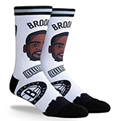 92% Polyester/ 7% elastine/ 1% nylon Officially licensed apparel by PKWY Crew length with Formed heel and Ribbed cuff Features Sublimated player and team logo graphics. Sizing: M (Women's shoe size 3-8; Youth shoe size 1-6) - L (Men's shoe size 6-12/...