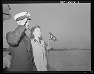 Detroit, Michigan. A Venetian night party at the Detroit yacht club, whose members represent the wealthier class of manufacturers and their friends. The Commodore with a girl, reviewing the fleet