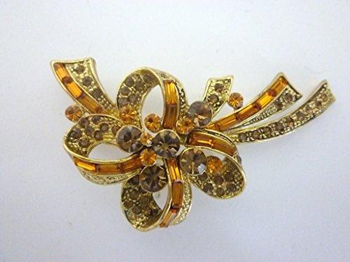 Dapo Leuchten Goldfarbene Brosche Schleife mit hochwertig verarbeiteten Kristallsteinen braun-orange Modeschmuck Geschenk
