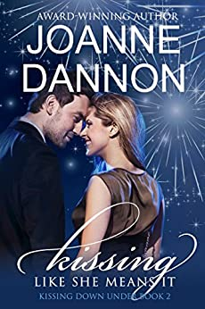 Kissing like she means it (Kissing Down Under Series Book 2) by [Joanne Dannon]