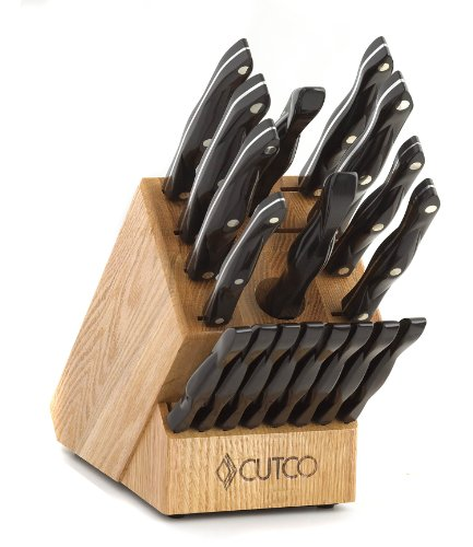 "CUTCO Model 2018 Homemaker+8 Set............Includes (8) #1759 Table Knives, (10) Kitchen Knives & Forks, #1748 Honey Oak knife block, #82 Sharpener, and #125 Medium Poly Prep cutting board.......... High Carbon Stainless blades and Classic Brown handles (sometimes called ""Black"").........in factory-sealed plastic bags."