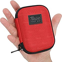 man holding travel first aid kit