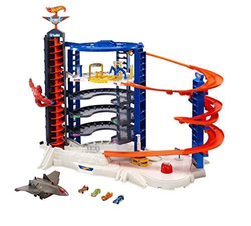 Hot Wheels - Super Ultimate Garage Playset per Macchinine con 4 Veicoli Inclusi, Giocattolo per Bambini 4+ Anni, FML03