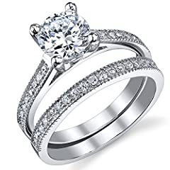 Pop the question with this Sterling Silver Cubic Zirconia 2-piece Bridal Wedding Ring Set. It features a glittering engagement ring with a 1.25 carat prong-set, round-cut, white cubic zirconia center stone and small, round-cut, white cubic zirconias ...