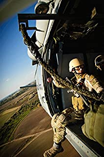 Posterazzi Poster Print Collection a US Navy Sailor Rides in an MH-60 Seahawk Helicopter Over Rota Spain Stocktrek Images, (22 x 34), Multicolored