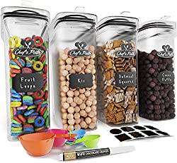 4 clear cereal containers with black chalkboard labels