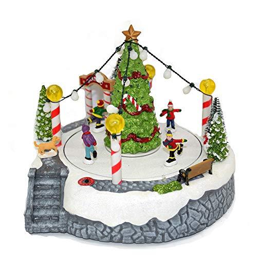 Villaggio di Natale innevato con Pista di pattinaggio TONDA e Pattinatori in Movimento su Laghetto, paesaggio con Luci LED e Musica Babbo Scenario Natalizio Parco Giochi Carillon 23x24x19cm