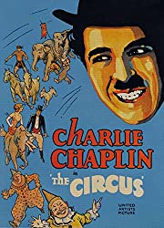 a very nice The Circus poster, with the face of Chaplin overshadowing the rest of the cast