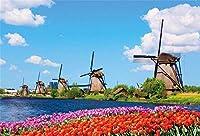 新しい9x6ftSpring風景写真背景オランダの典型的な風景古い風車の家青い空川チューリップ花花壇背景旅行パーティー子供大人の肖像画スタジオ小道具