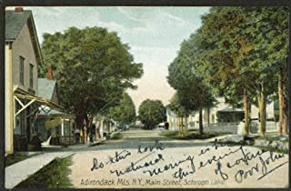 View up Main Street Schroon Lake NY postcard 1908