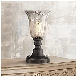 """13"""" high overall. Glass is 7"""" high x 6 3/4"""" wide. Base is 6 1/4"""" wide. Uses one maximum 40 watt standard-medium base bulb (not included). In-line on-off switch. Accent uplight table lamp from the Regency Hill collection of table lamps. Dark bronze fi..."""