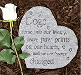 A stone heart shaped dog memorial with writing on it