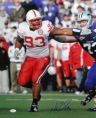 Ndamukong Suh Autographed Nebraska 16x20 Stiff Arm Photo- JSA Authenticated