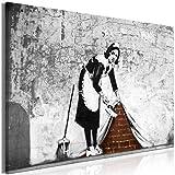 murando - Bilder Banksy Sweeping Under The Wall 120x80 cm