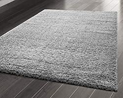 DESIGN STATEMENT - This solid rug is plain and simple with an elegant transitional design. This shaggy rug constructed from thick, luxurious, twist pile fibres, has been designed with that sumptuous modern feel with that vintage style and colour whi...