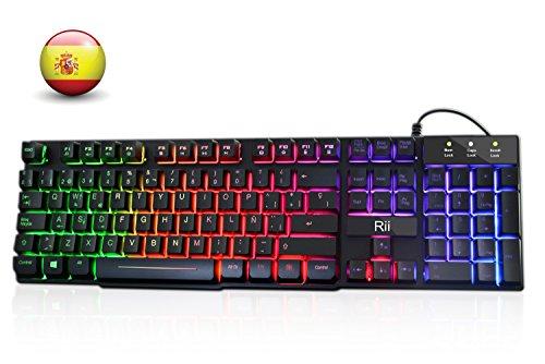 Rii RK100+ Novedoso Teclado USB Retroiluminado,Colores Rainbow y Panel metálico Resistente,Alta sensibilidad Ideal para Jugar, QWERTY con Layout Español Teclado espandido.