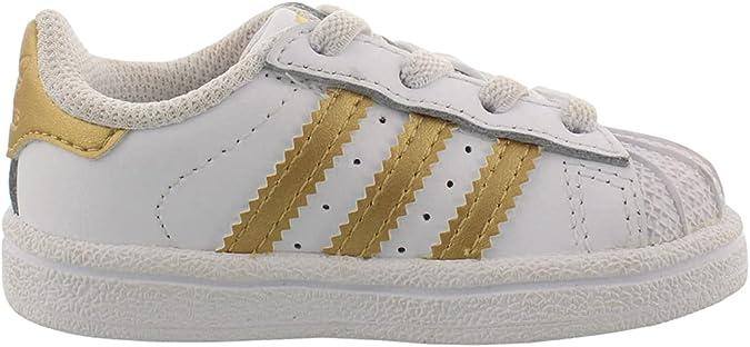 adidas Originals Kids Superstar Shoes Sneaker, White/Gold Met./Blue, 4 US Unisex Toddler