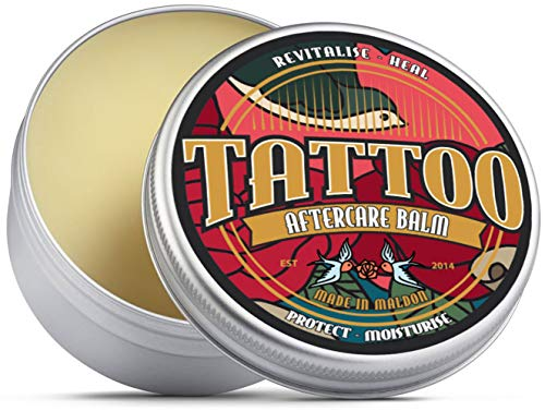 Bálsamo para cuidados posteriores de tatuaje Revitaliza, sana, protege e hidrata. Manteca de karité, árbol de té, eucalipto, jojoba, aceite de cáñamo y cera de abeja.