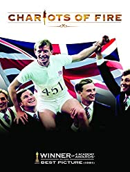 Promotional image for Chariots of Fire showing Ian Charleson as Eric Liddell being held aloft by men with large Union Jack flag in background
