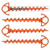 This photo shows a set of four Orange Screw Ultimate Ground Anchor camping tent stakes.