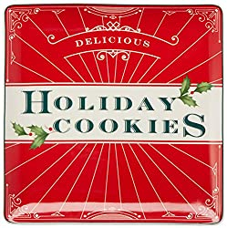 "A red suare ceramic platter that says ""Delicious Holiday Cookies"""