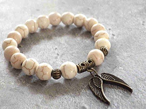 Miss Chichi elegante pulsera turquesa blanca reconstituida con colgante en forma de alas de ángel