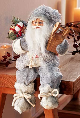 """Kantenhocker """"Schlittentour"""" 30 cm hoch, Deko Weihnachtsmann, Nikolaus, Santa-Claus-Figur, sitzend"""