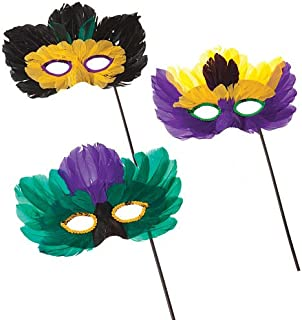 mardi gras feather masks on a stick