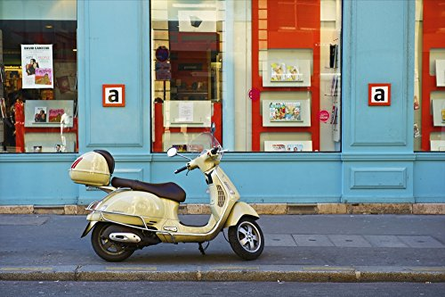 The Poster Corp Ingrid Rasmussen/Design Pics – A Motorized Scooter Parked Outside a Blue Building Along a Street Canal Saint Martin; Paris France Photo Print (48,26 x 30,48 cm)