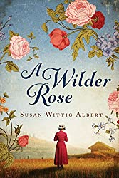 Image: A Wilder Rose: A Novel | Kindle Edition | by Susan Wittig Albert (Author). Publisher: Lake Union Publishing (March 17, 2015)