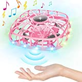 UPGRADED OPERATION MUSIC UFO DRONES: Our upgraded hand operated drones difference compared to others which has dynamic music function. Just turn the switch to music mode, let the LED lights flash on the horizontal plane for three seconds before flyin...