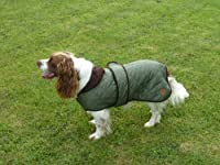 A classic diamond quilted dog coat Traditional tartan lining Corduroy collar & trim Velcro fastening for easy adjustment
