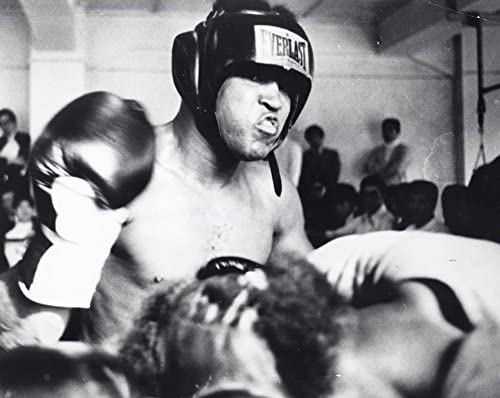 Muhammad Ali wearing a boxing helmet and boxing gloves Photo Print 10 x 8 product image