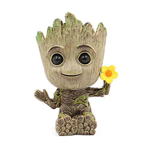 baby Groot flowerpot holding yellow flower