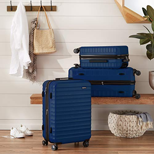 AmazonBasics Hardside Carry-On Spinner Suitcase Luggage - Expandable with Wheels - 21 Inch, Navy Blue