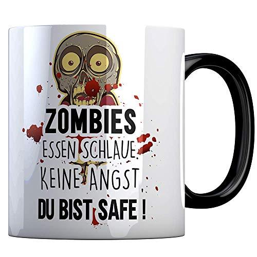 Tassenbude Tasse mit lustigem Spruch und Zombie Motiv - zombies essen schlaue keine angst du bist safe - Büro/Job/Arbeit/Witzig/Kaffee-Tasse/Geschenk-Idee beidseitig bedruckt spülmaschinenfest schwarz