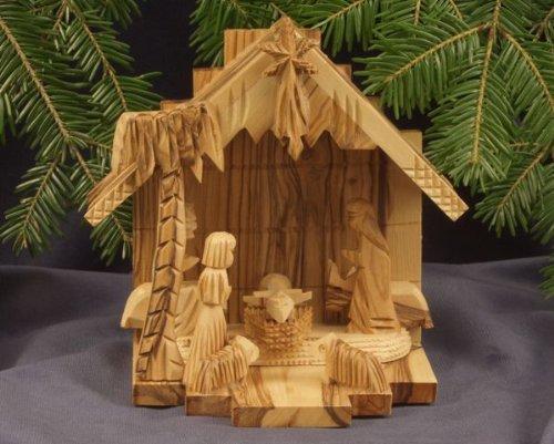 Krippenstall mit Krippenfiguren,Palme und Stern. In Bethlehem handgeschnitzt aus Olivenholz. Original FIGURA SANTA Qualität. Höhe ca. 15 cm.